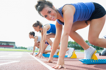 Happy woman at starting blocks © WavebreakmediaMicro - Fotolia.com